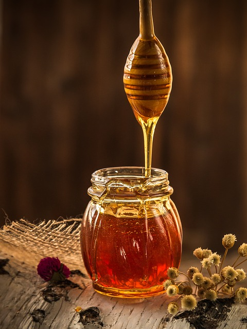 a jar of honey and one of those weird honey spoons, you know the ones I mean