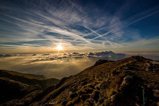 Sun rising over mountains.