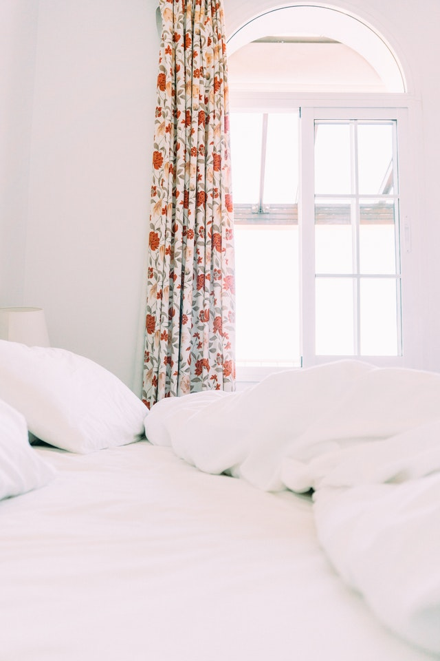 white-room-with-floral-curtain-2320016